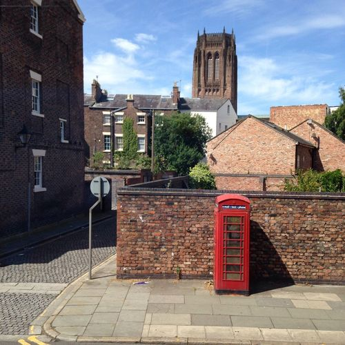 Red Telephone Booth On Street