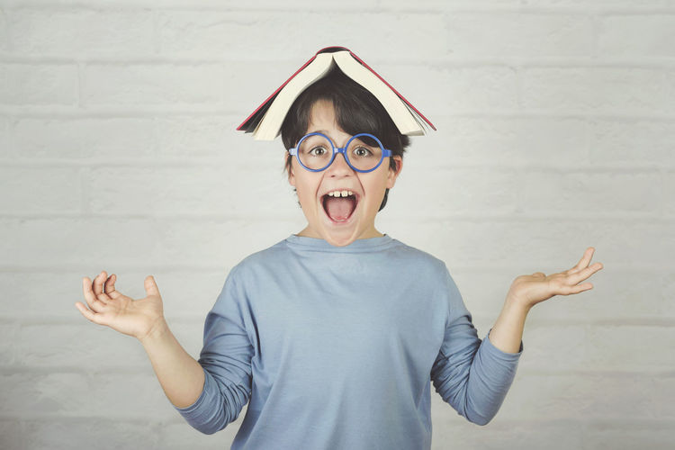 Child Childhood Standing Mouth Emotion Facial Expression Headshot Portrait Book Education Wisdom Know Learning Learn Study Studying Study Time Student School Schoolboy Smile Lifestyle Fun Funny Glasses Concept Read Reading Lesson Homework Ready Genius Educational Intelligence Intelligent Happy Happiness Expression Inspiration Idea Textbook Cute People Playing Reading A Book Class Laughing
