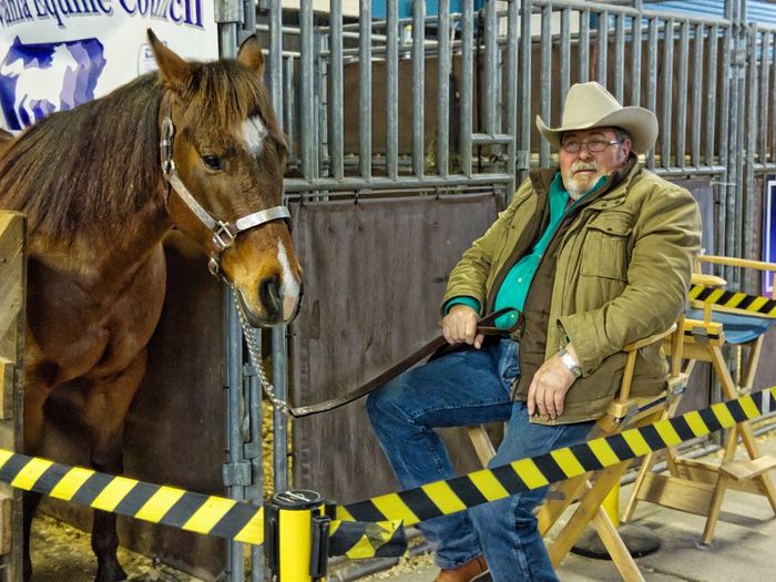 Donations for Retired Horses Volunteer Farmlife Hanging Out Farm Show Senior Adult Cowboy Hat Animal Love Animal Themes Awareness Documentary Photography Mammal Domestic Day One Person Pets Real People Warm Clothing Lifestyles Winter