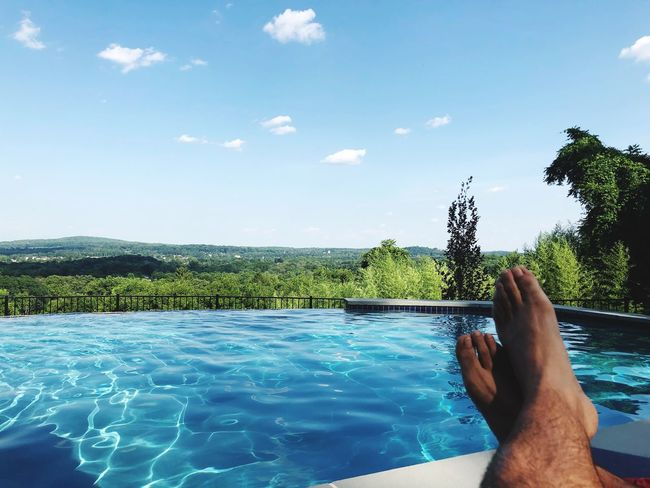 Water Human Body Part Human Leg Sky One Person Low Section Body Part Real People Swimming Pool Nature barefoot Lifestyles Personal Perspective Leisure Activity Beauty In Nature Pool