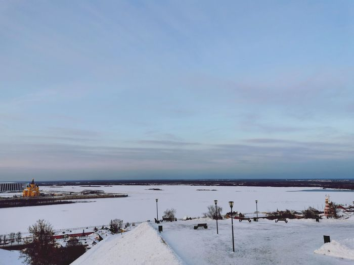 Scenic view of snow covered sea against sky