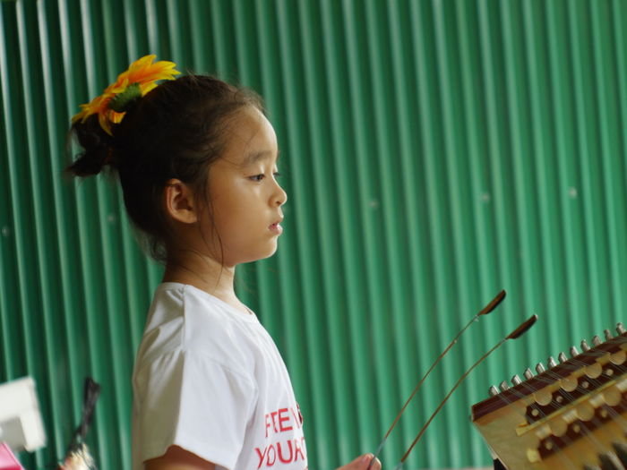 Side view of girl playing musical instrument