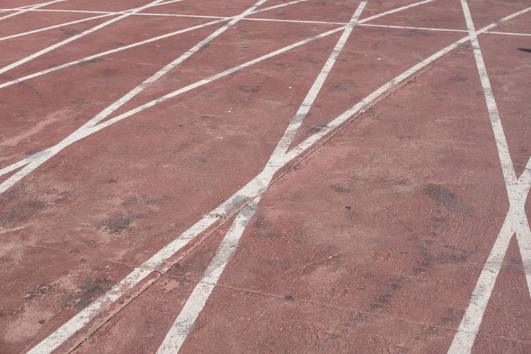 Athlete Absence Athletism Backgrounds Competition Competitive Sport Day Direction Dividing Line Empty Full Frame High Angle View No People Outdoors Pattern Red Road Running Track Sport Sports Symbol The Way Forward Track And Field
