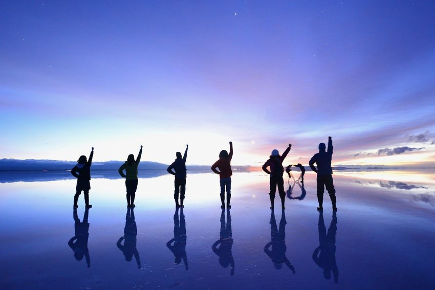 Famous ONE PIECE pose in Uyuni salt flat, Bolivia One Piece Reflcetions Adult Arms Raised Beauty In Nature Friendship Full Length Horizon Over Water Large Group Of People Leisure Activity Lifestyles Men Nature Outdoors People Real People Silhouette Sky Standing Sunrise Togetherness Water Women Young Adult