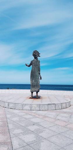 Statue of sea against blue sky