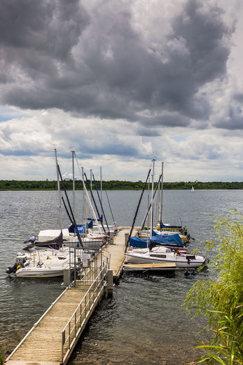 Yachts moored on Markkleeberger See (Markkleeberger Lake) in the Markkleeberg suburb of Leipzig in Saxony, Germany. Dark Clouds Markkleeberger Lake Markkleeberger See Markkleebergersee Beauty In Nature Cloud - Sky Clouds Lake Markkleeberg Moored Mooring Nature Nautical Vessel Outdoors Sailing Scenics Sky Storm Cloud Tourist Destination Tranquility Transportation Travel Destinations Water Waterfront Yacht