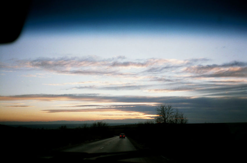 Olympus Mju Ll Beauty In Nature Car Cloud - Sky Daydreaming Fujisuperia100 Landscape Nature No People Outdoors Road Roadtrip Scenics Silhouette Sky Sunset The Way Forward