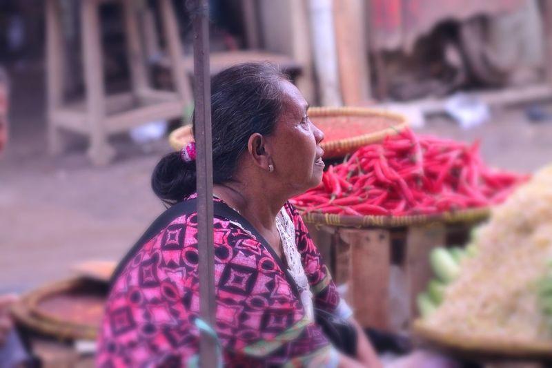Vendor selling vegetables at market