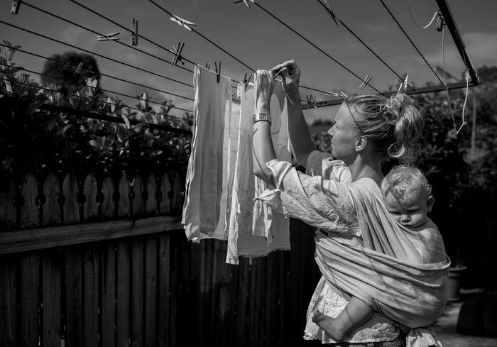 Woman hanging laundry