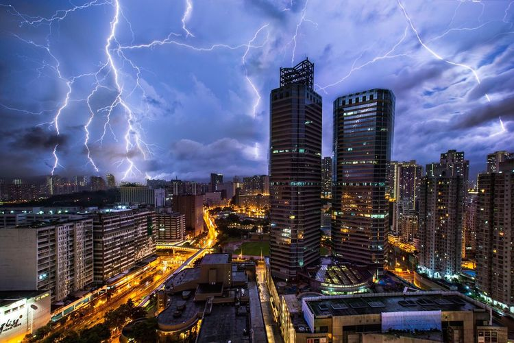 Lightning strike against illuminated buildings