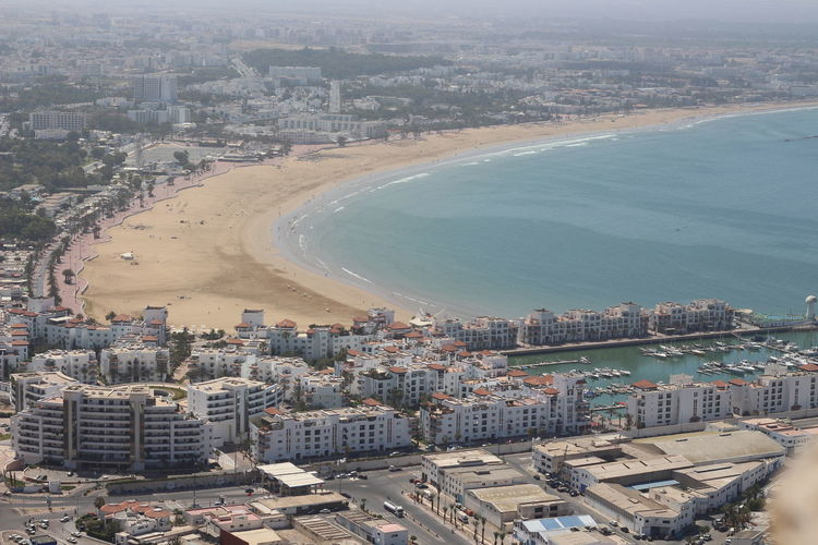 Beach Imor Building Exterior Architecture Cityscape Built Structure Aerial View Water City High Angle View Building Office Building Exterior Outdoors Day Crowded Transportation Nature Residential District Sea Travel Destinations Skyscraper Beach Agadir Morocco Agadir Beach Sunlight