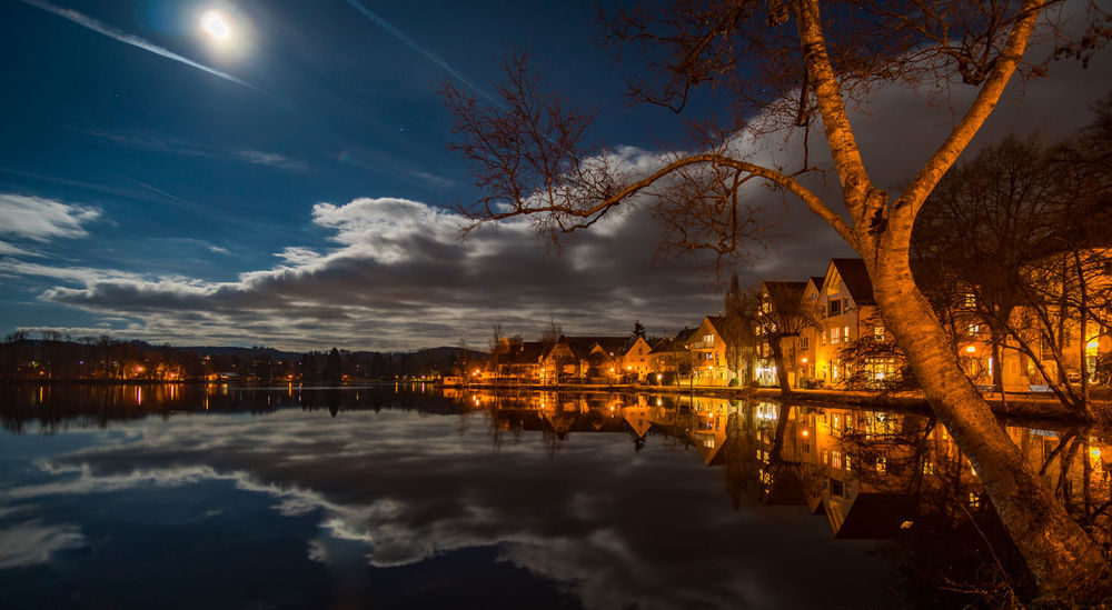 The lake in Bad Waldsee at night Bad Waldsee Moon Architecture Beauty In Nature Building Exterior Built Structure Cloud - Sky Fullmoon Illuminated Lake Moonlight Nature Night No People Outdoors Plant Reflection Scenics - Nature Sky Tranquility Tree Waldsee Water Waterfront