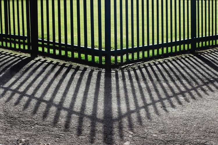 Cropped railings with shadows