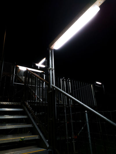 Low angle view of illuminated staircase at night