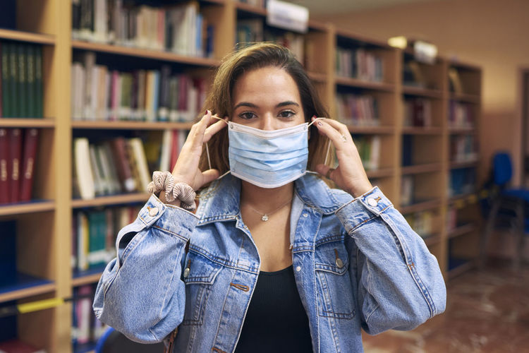 Portrait of a girl wearing a mask to enter the library