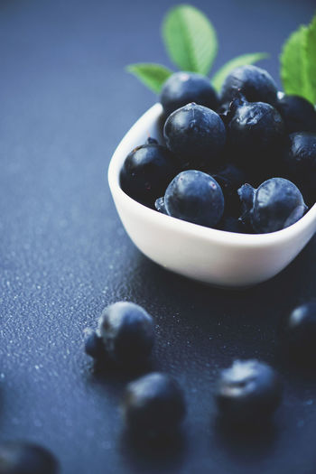 Close-up of black fruits in bowl on table