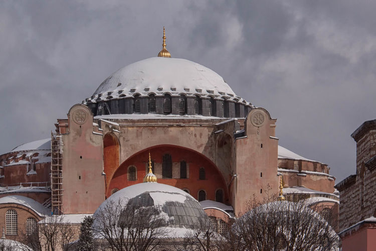 Snow Covered Hagia Sophia Architecture Architecture, Attraction, Aya, Background, Blue, Building, Cathedral, Christian, Church, Detail, Exterior, Faith, Field, Great, Green, Hagia, Heaven, Historical, History, Holiday, Horizontal, Islam, Islamic, Istanbul, Landmark, Landscape, Minaret, Mosque, Building Exterior Built Structure Cathedral Church Cross Culture Dome Façade Famous Place Hagia Sophia, Church, Mosque, Sultan Ahmet History Place Of Worship Religion Spirituality Turkey, Istanbul, Sultan Ahmet, Europe, European, Middle East Winter, Snow, Cold, White, Weather, Trees,