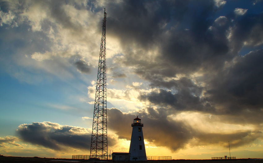 North Cape, P.E.I, Canada / Winter Aerogenerator Clooud Lighthouse North Prince Edward Island Sea And Sky Sky And Clouds Summer Sunset Sunset Silhouettes Sunset_collection Tourism Travel Destinations Travel Photography Wind Generator