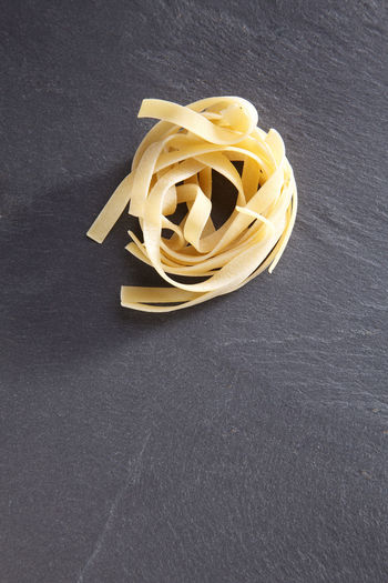 Close-up of pasta on slate
