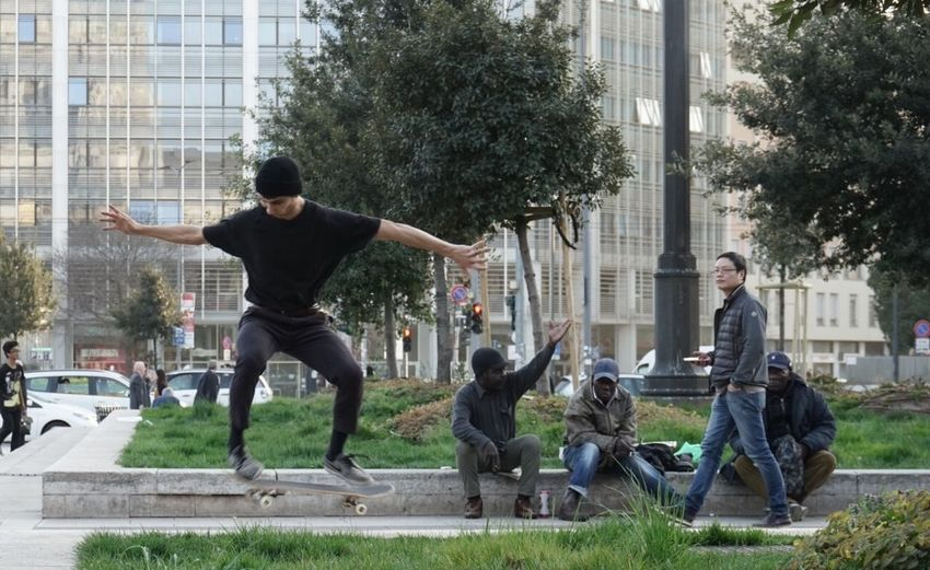 Men playing in city