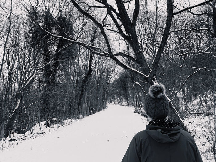 Rear view of woman on snow covered land