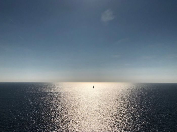 Boat in the sun Sun Sail Boat Water Sky Horizon Over Water Sea Horizon Scenics - Nature Beauty In Nature Tranquility No People Sunlight First Eyeem Photo