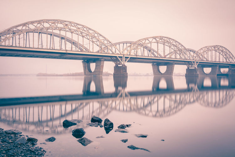 New Darnytskyi Bridge Over Dnieper River With Reflection Against Sky