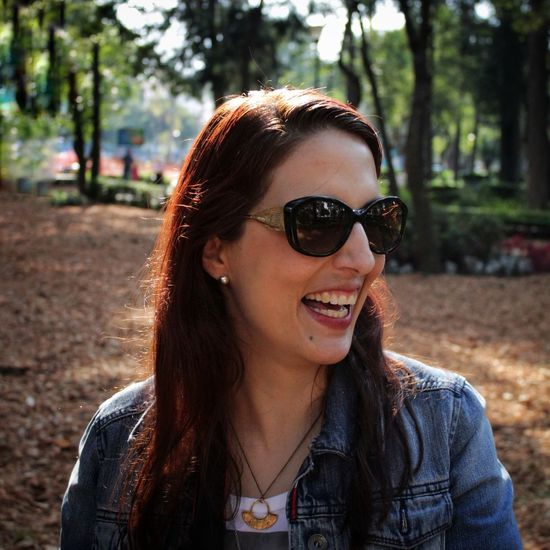 Close-up of happy young woman wearing sunglasses