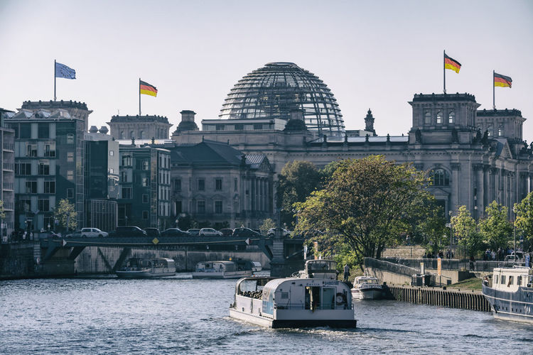 Reichstag building with Spree River in the afternoon Berlin Germany 🇩🇪 Deutschland Horizontal Color Image Outdoors No People Water Flag Architecture Built Structure Building Exterior Reichstag Spree River Transportation Nautical Vessel Waterfront Mode Of Transportation River Day Government Passenger Craft National Icon Architecture Sightseeing River Cruise Boat