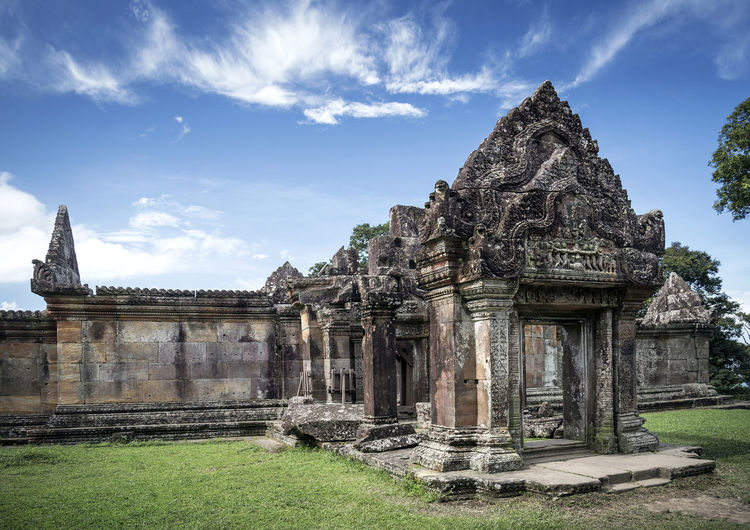 Old temple against cloudy sky