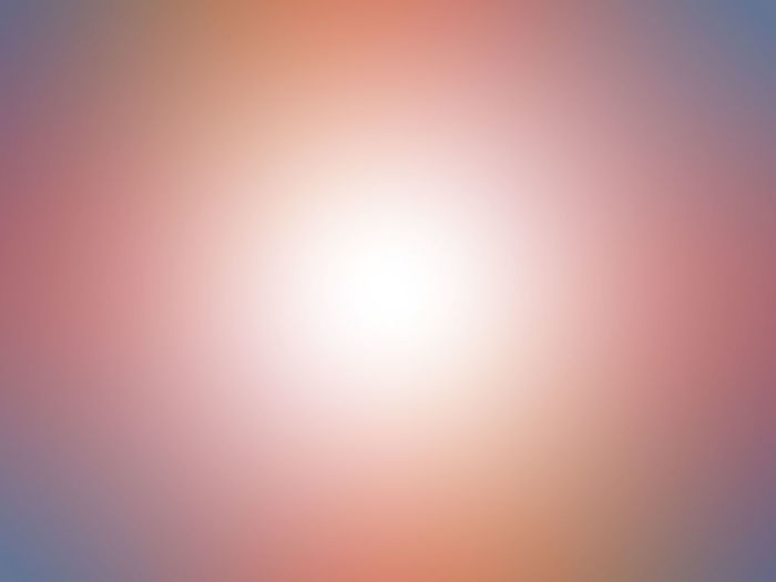 Defocused image of pink sky at sunset