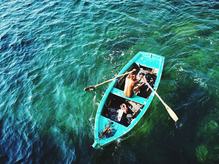 High angle view of man on boat in sea