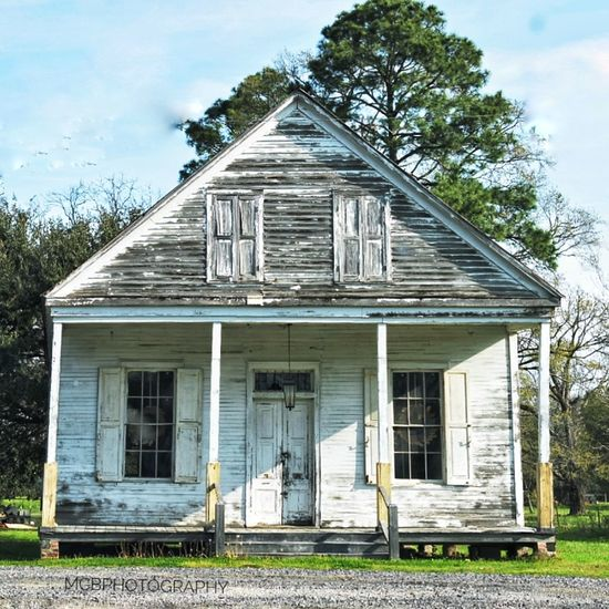 Architecture Building Exterior House Built Structure Home Ownership Residential Building Tree No People Façade Weathered Outdoors Sky Day South Louisiana Exteriorphotography Neglected Weathered Whitewashed Whitewashed Houses Porch