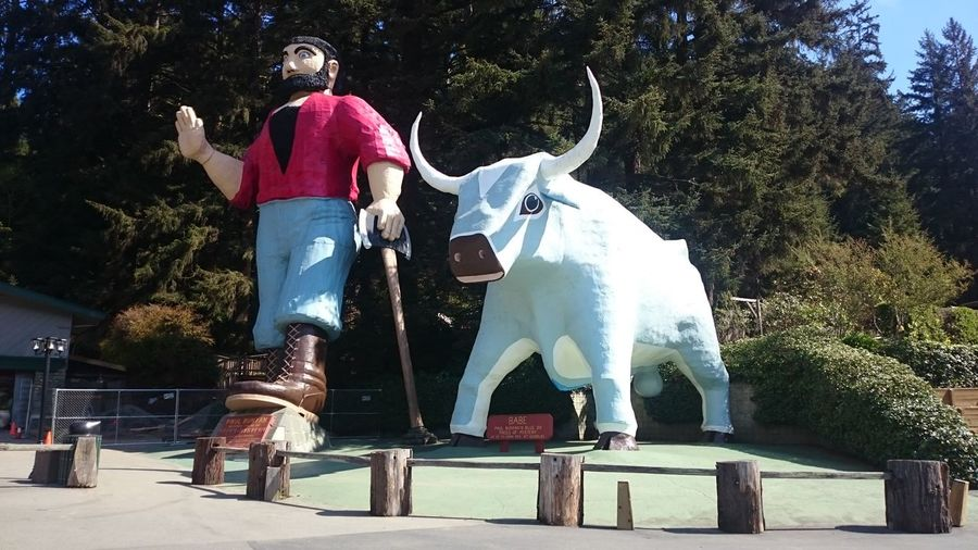Adult Animal Themes Babe The Blue Ox Child Day Full Length One Man Only One Person Only Men Outdoors Paul Bunyan People Statue Tree