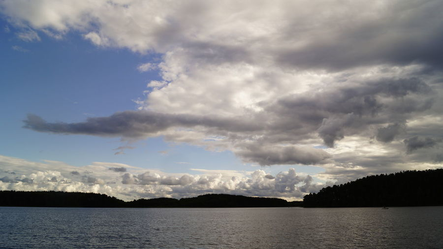 Beauty In Nature Cloud - Sky Day Mountain Nature No People Outdoors Scenics Sea Silhouette Sky Storm Cloud Tranquil Scene Tranquility Tree Water