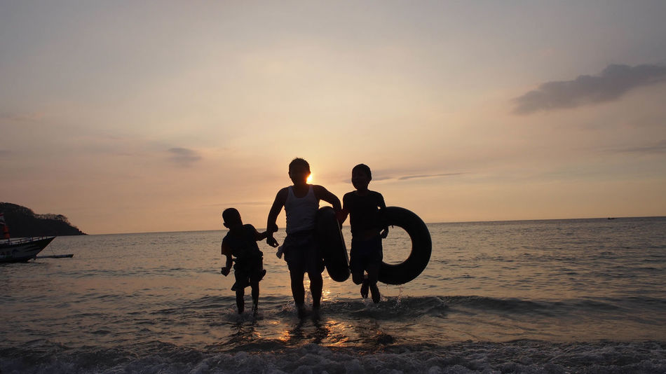 Silhouette at the beach Lombok-Indonesia Sunset_collection Travel Photography Beach Beauty In Nature Group Of People Horizon Horizon Over Water Land Leisure Activity Lifestyles Men Nature People Positive Emotion Real People Scenics - Nature Sea Silhouette Sky Sunset Togetherness Water