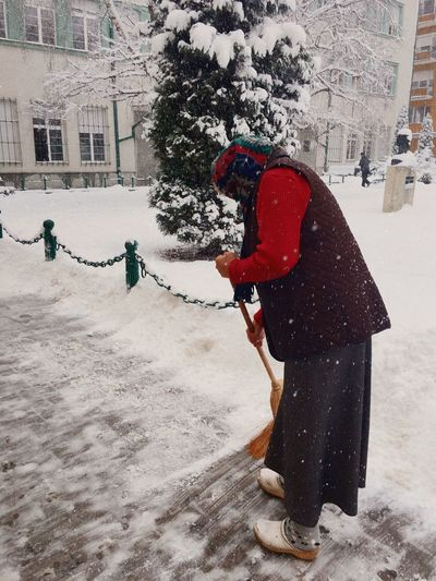 Winter Snow Full Length Cold Temperature Real People Weather Warm Clothing Day Outdoors Red One Person Snowing Tree Women Side View Cleaning