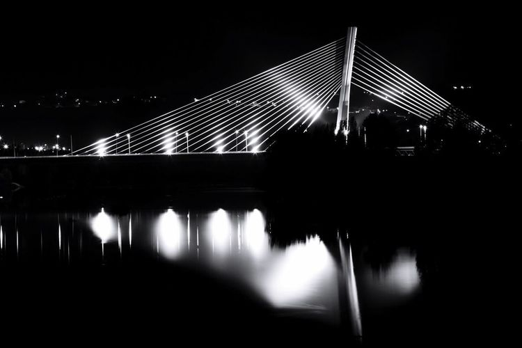 Bridge - Man Made Structure Architecture Connection Illuminated Night Built Structure Transportation Suspension Bridge Reflection Outdoors No People City Sky Clear Sky Water Ponte Rainha Santa Isabel