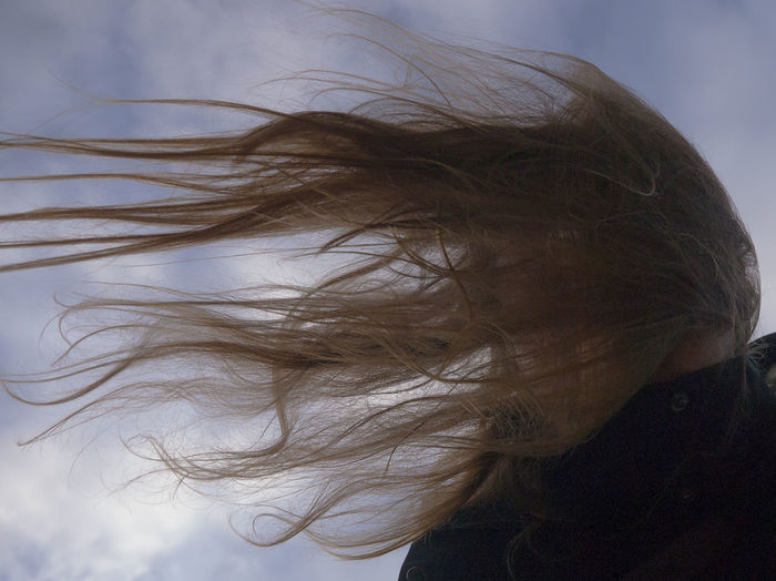 Close up of long blonde hair being blown sideways by the wind Hair One Person Long Hair Real People Adult Human Hair Headshot Wind Tousled Hair Portrait Close-up Obscured Face Colour Image Color Image Low Angle View Windy Day Outdoors Blue Sky Clouds And Sky Messy Medusa Woman Day