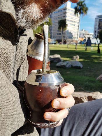 Tomando mate Mate Termo Drink Mate Uruguay Culture And Tradition Yerba Mate Yerba Nacional Drink Brevage Human Hand Men Close-up Urban Scene