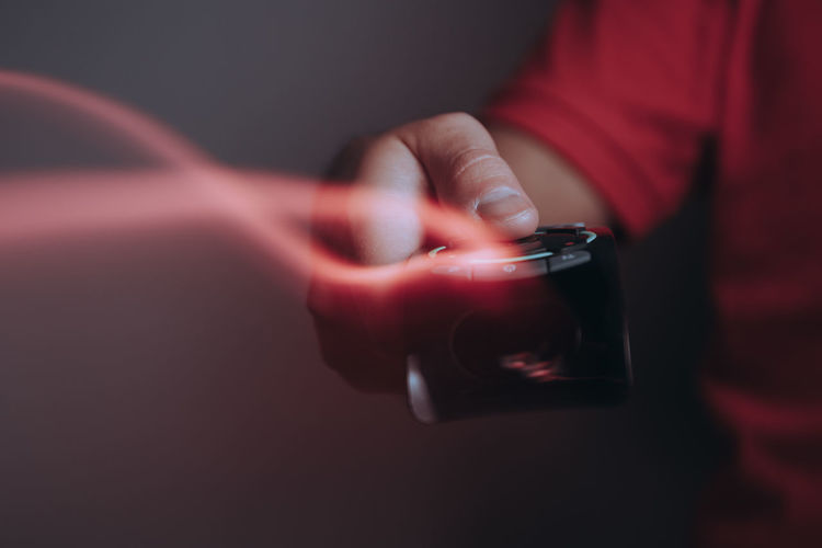 Close-up of hand holding mobile phone