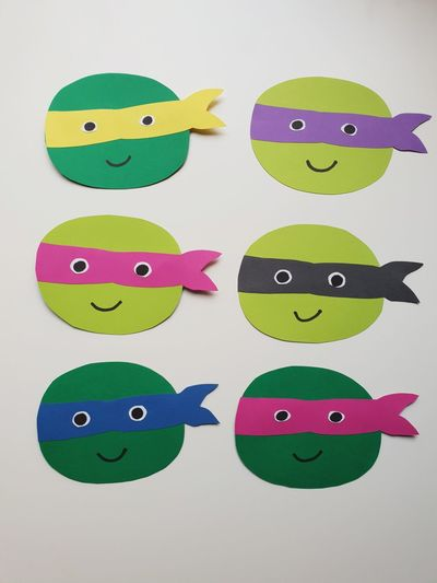 turtles Arts And Crafts Paperwork Creativity Birthday Party Presents Turtles Ninja Turtles Colorfull Give Away No People On The Table White Background Minimalism Table Playing Mother And Son Childhood Shades Of Green  Variety Anthropomorphic Face Smiling Child Happiness Anthropomorphic Smiley Face Cute Paper Fun Green Color Smiley Face