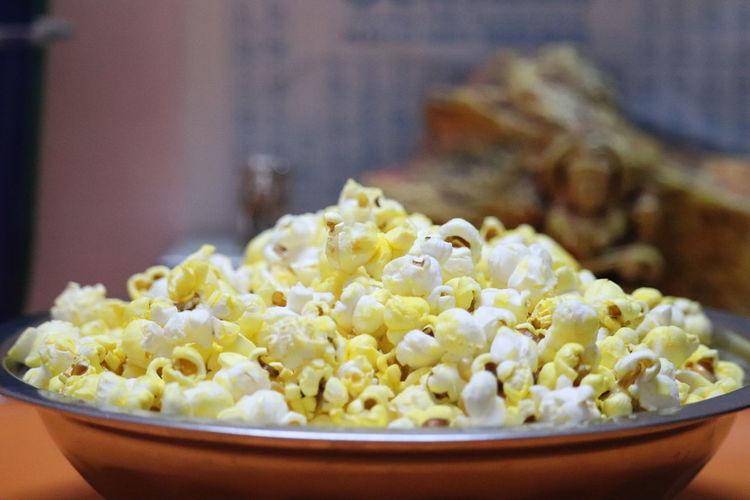 Close-up of popcorn in plate on table