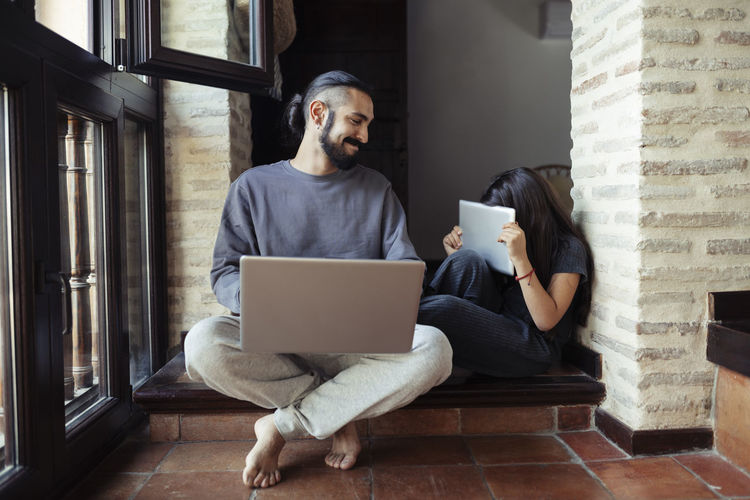Man using laptop while sitting at home