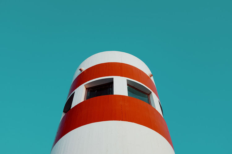 Low Angle View Of Lighthouse Against Clear Blue Sky
