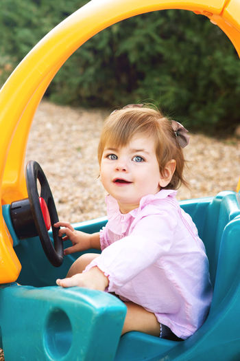 Cute baby girl sitting at park