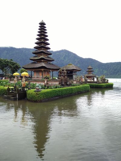 a temple at Beratan Lake, Bedugul, Bali, Indonesia Architecture Beauty In Nature Building Exterior Built Structure Day Lake Mountain Nature No People Outdoors Scenics Tranquil Scene Tranquility Travel Destinations Water Waterfront Bedugul Bali, Indonesia Bedugul Temple Bedugulbali