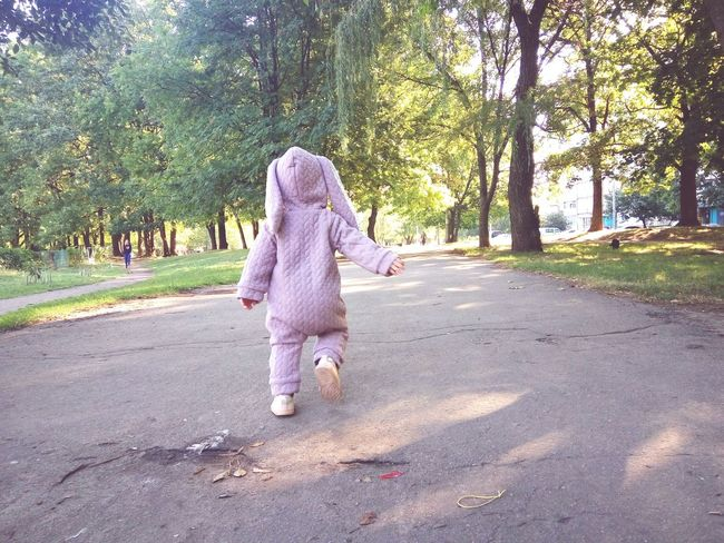 Baby girl like a rabbit running in summer city Rabbit Baby Girl Kid Child City Summer Walking Tree Full Length Women Rear View Walking One Baby Girl Only Little Baby Clothing Personality  Baby Girls Young