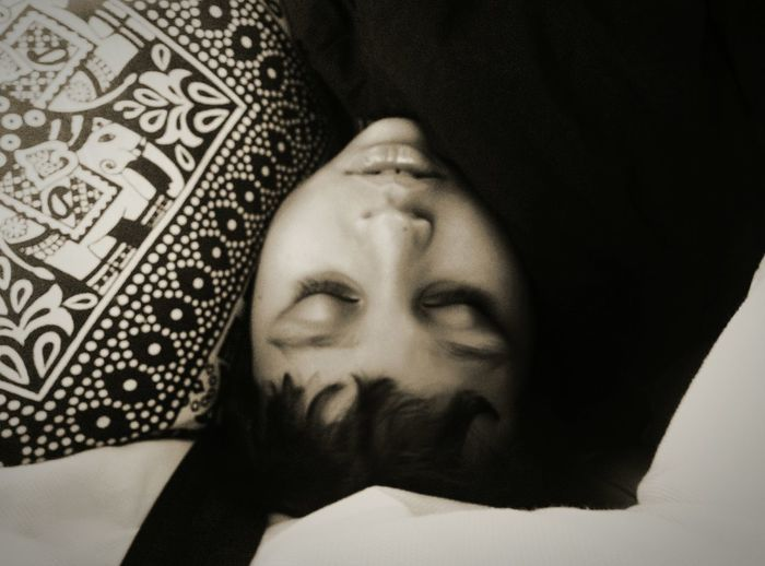 High angle view of boy sleeping on bed at home
