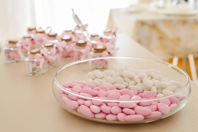 Sugared almonds for christening day Sugared Almonds Almond Bowl Candy Christening Day Close-up Container Focus On Foreground Food Food And Drink Indoors  No People Pink Color Still Life Sweet Sweet Food White Color